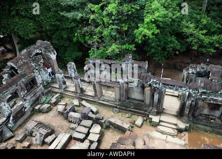 Ruins of a tempel in the ancient city Angkor Thom, Cambodia - Stock Photo