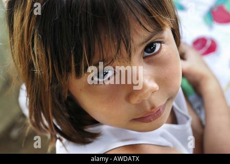 Cute girl looking up, Amazon Basin, Brazil - Stock Photo
