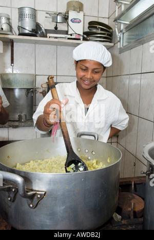 Adolescent girl in a industrial kitchen, Petropolis, Rio de Janeiro, Brazil - Stock Photo
