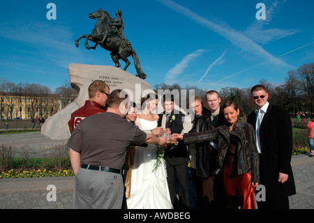 Wedding party in front of the Peter the Great monument, St. Petersburg, Russia - Stock Photo