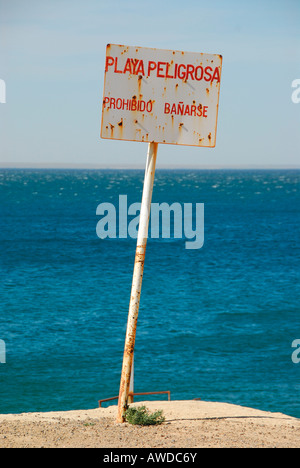 No swimming: warning sign near Puerto Madryn, Chubut province, Patagonia, Argentina - Stock Photo