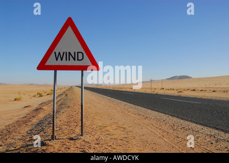 Road sign warning of wind gusts on a highway near Luederitz, Namibia, Africa - Stock Photo