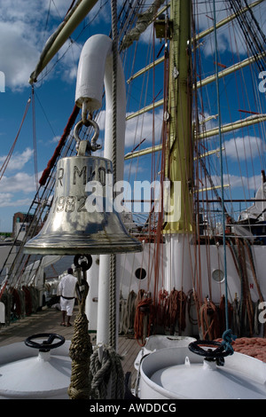 Tall ship Dar Mlodziezy, ship's bell - Stock Photo