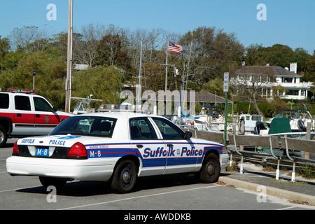 Suffolk County Marine Bureau Police car on Bellport marina Long Island New York USA - Stock Photo