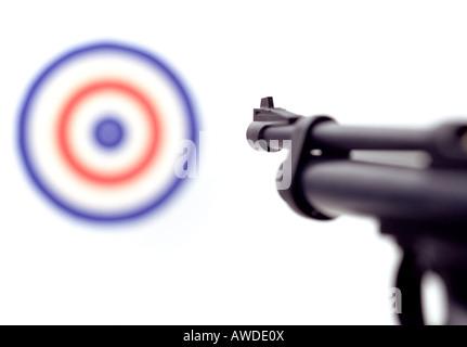 Gun pointing at target. - Stock Photo