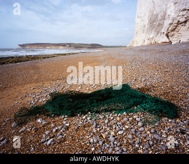 Discarded fishing net, washed onto a beach. Cuckmere Haven, East Sussex, England, UK. - Stock Photo