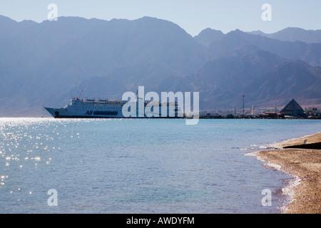 Nuweiba Muzeina Gulf of Aqaba Sinai Peninsula Egypt Cargo ship in port on Red Sea east coast - Stock Photo