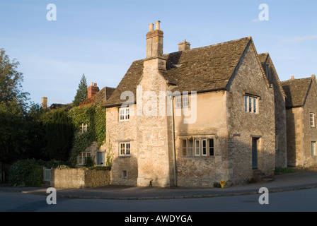 Three quarter view of a stone cottage on the corner of the High Street and West Street in the National Trust vilage - Stock Photo