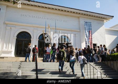CALIFORNIA Santa Barbara Group of high school students walking up steps to Santa Barbara Art Museum educational - Stock Photo