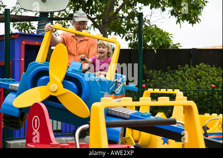 Dad and daughter on a ride Legoland Carlsbad, California, USA - Stock Photo