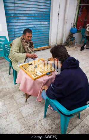 two Egyptian men playing backgammon in the back street of Old Sharm Sinai Egypt - Stock Photo