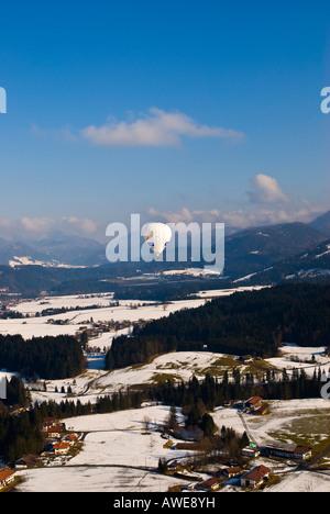 Hot air balloons over Kaiserwinkel, Tirol, Austria, Europe - Stock Photo