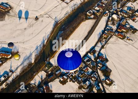 Hot air balloons flying over Koessen, Kaiserwinkel, Tirol, Austria, Europe - Stock Photo