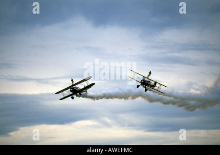 Aerial shot of two Boeing PT-17 Stearman biplanes with wingwalkers - Stock Photo