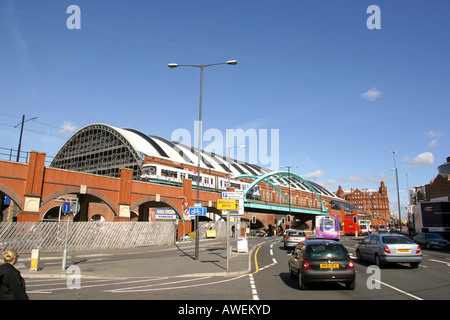 Manchester G Mex Centre old Central Rail Station and Metrolink Tram passing Lower Moseley Street - Stock Photo