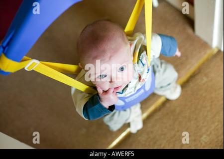 Baby in a door bouncer Stock Photo: 75539189 - Alamy