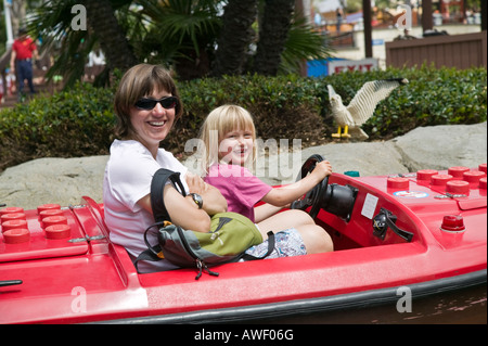 Mom and daughter on a ride Legoland Carlsbad, California, USA - Stock Photo
