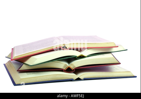 Four old books open and on top of each other isolated on white - Stock Photo