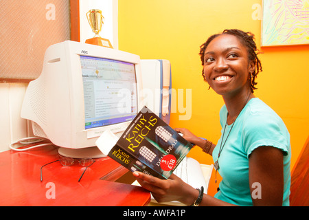 Student, young woman of African ethnicity working on computer, Georgetown, Guyana, South America - Stock Photo