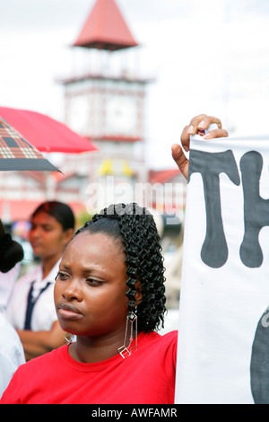 Young woman of African ethnicity protesting violence against women, Georgetown, Guyana, South America - Stock Photo