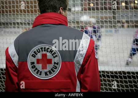 German Red Cross worker at a hockey game in Burgkirchen, Upper Bavaria, Bavaria, Germany, Europe - Stock Photo
