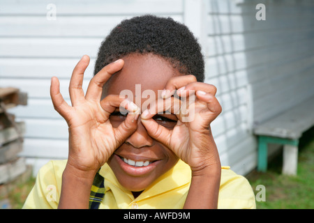 Young Woman With Fingers Around Eyes Making A Funny Face