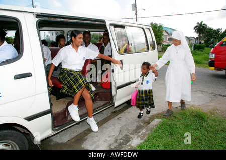 School bus picking up children, everyday life at an Ursuline convent and orphanage in Georgetown, Guyana, South - Stock Photo