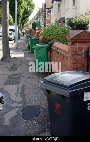 Black rubbish green recycling wheelie bins in a Cardiff suburb Penylan Cardiff UK - Stock Photo