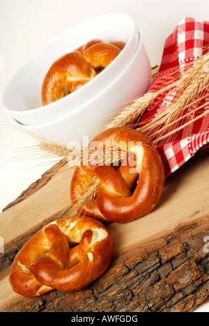 Pretzels and grain ears - Stock Photo