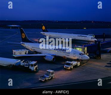 Lufthansa airplanes being loaded at night, Frankfurt International Airport, Frankfurt, Hesse, Germany, Europe - Stock Photo
