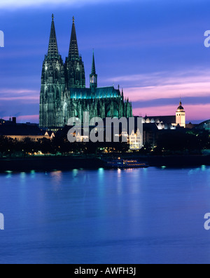 Cologne Cathedral and the Rhine River at dusk, Cologne, North Rhine-Westphalia, Germany, Europe - Stock Photo
