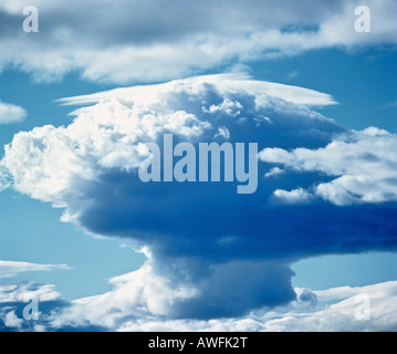 Cumulonimbus thunderclouds in a blue sky, approaching thunderstorm - Stock Photo