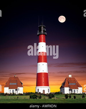 Composing shot: Westerheversand Lighthouse by the full moon, Westerhever, Eiderstedt Peninsula, Schleswig-Holstein, - Stock Photo