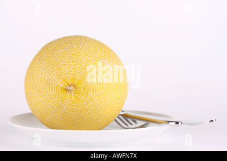 Melon on a plate with cutlery