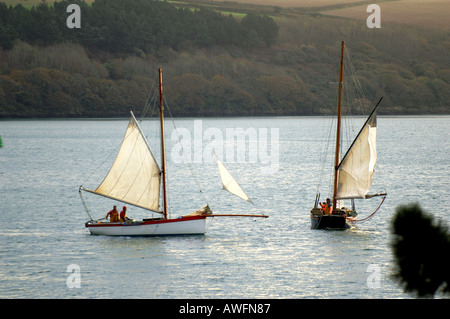 Oyster dredging from a Falmouth working boat under sail in the Carrick Roads near Falmouth Cornwall England UK GB - Stock Photo