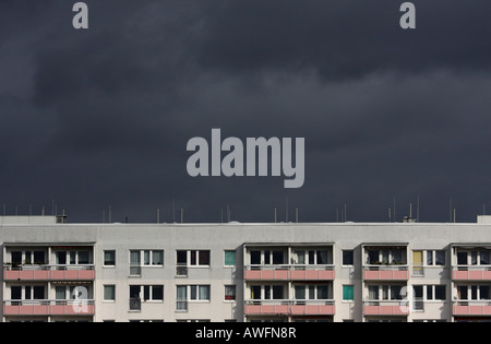 Dark thunderclouds forming over an apartment building - Stock Photo