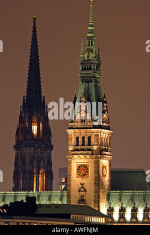 Towers of the town hall of Hamburg and the St. Nikolai church in the background in evening light - city of Hamburg - Stock Photo