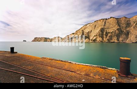 Tolaga Bay Wharf and headland North Island New Zealand - Stock Photo
