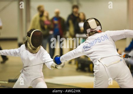 Sports Fencing Competition Two Women Holding Epee Weapons