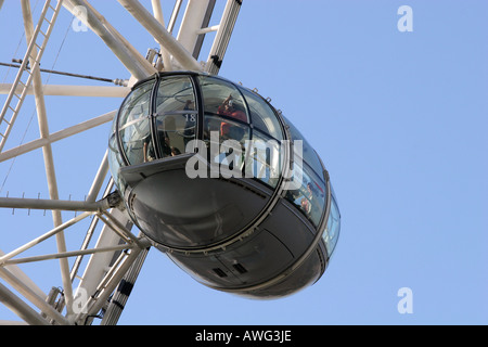 Closeup of a tourist filled capsule pod on the popular landmark tourism attraction The London Eye UK Europe - Stock Photo