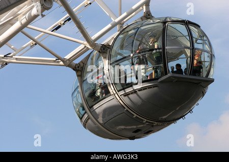 Closeup of a tourist filled capsule pod on the popular landmark tourism attraction - Stock Photo