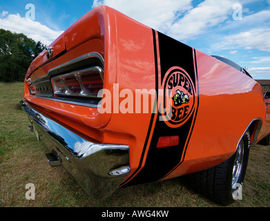 Wide angle shot of the logo for an orange 1969 Dodge Superbee, mid-century - Stock Photo