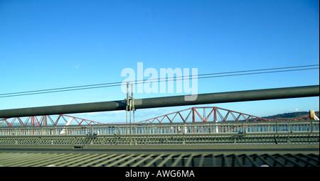 Forth Rail Bridge viewed through suspension cables of Forth Road Bridge Edinburgh Scotland - Stock Photo