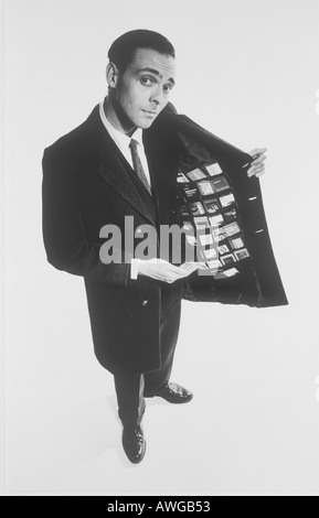 A man holding his jacket open showing many business credit cards - Stock Photo