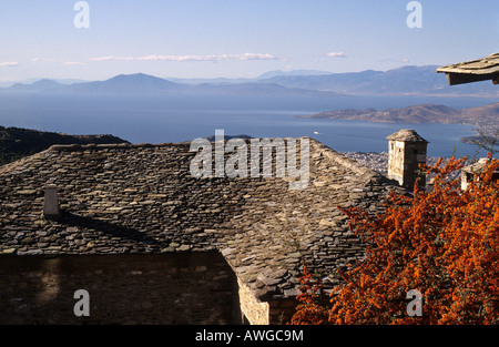 central greece thessaly pelion pilion village of makrinitsa view over a rooftop to the bay of volos - Stock Photo