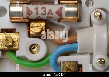 Close-up showing the inside of a standard british 13 amp electrical plug. - Stock Photo