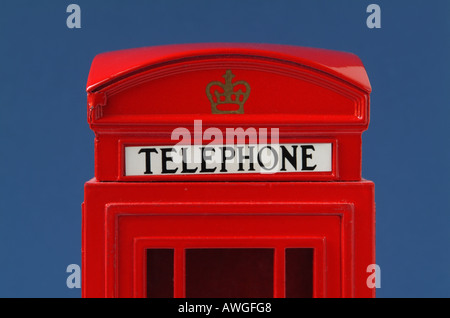 The top of a red telephone money box - Stock Photo