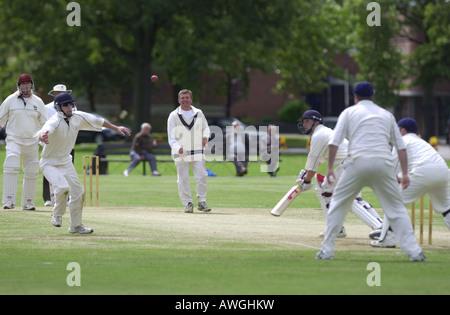 Batsman narrowly avoids being caught in a cricket match UK - Stock Photo