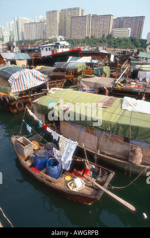 Hong Kong Island, house boats crowded together in Repulse Bay with high-rise apartments blocks above - Stock Photo