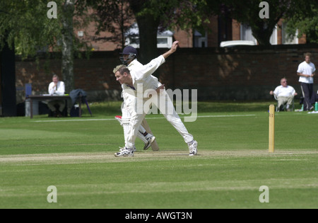 Bowler in cricket match UK - Stock Photo